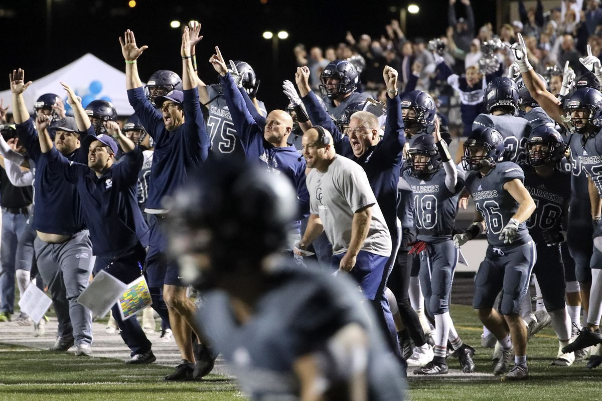 The Corner Canyon bench explodes with excitement after they scored the game-winning touchdown with two seconds left in the game, giving them a victory over Lone Peak at Corner Canyon High School in Draper on Friday, Sept. 27, 2019.