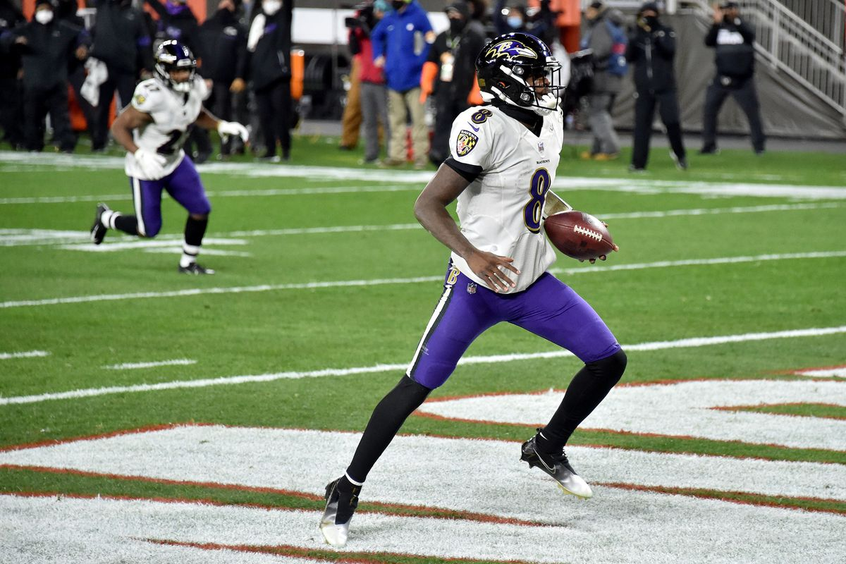 Lamar Jackson of the Baltimore Ravens rushes for a touchdown during the first quarter against the Cleveland Browns in the game at FirstEnergy Stadium on December 14, 2020 in Cleveland, Ohio.