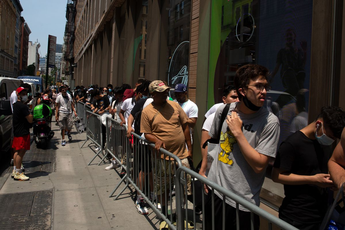 Shoppers wait for a sneaker release at the SoHo Nike store, July 6, 2021.