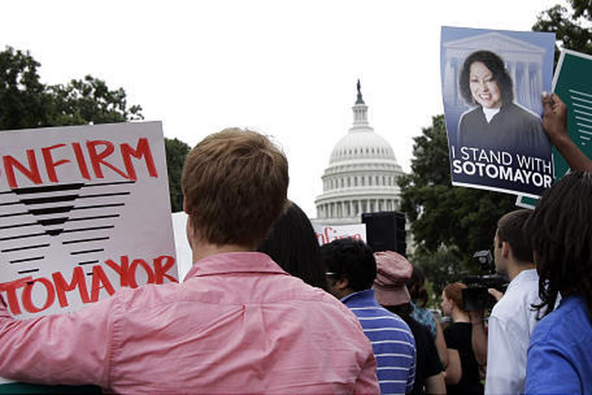 Supporters of Supreme Court nominee Sonia Sotomayor participate in a rally on Capitol Hill on Wednesday.
