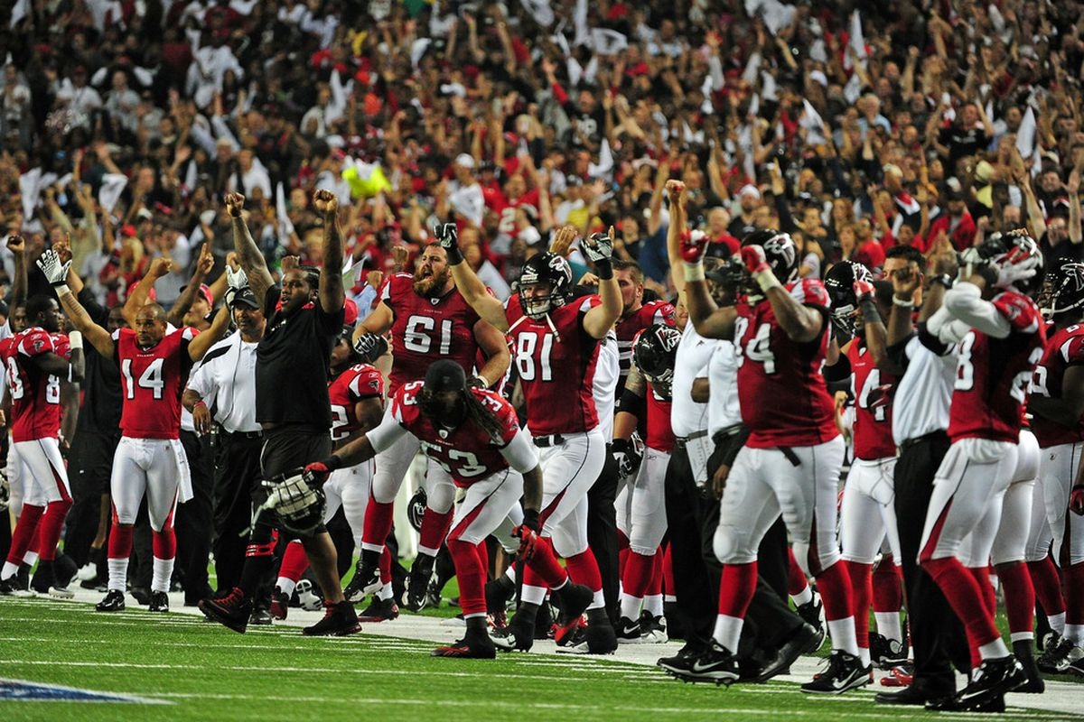 ATLANTA - SEPTEMBER 18: Members of the Atlanta Falcons celebrate after the game against the Philadelphia Eagles at the Georgia Dome on September 18, 2011 in Atlanta, Georgia. (Photo by Scott Cunningham/Getty Images)