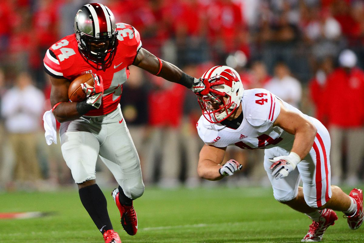 Carlos Hyde stiff arms his way to another solid run for Ohio State