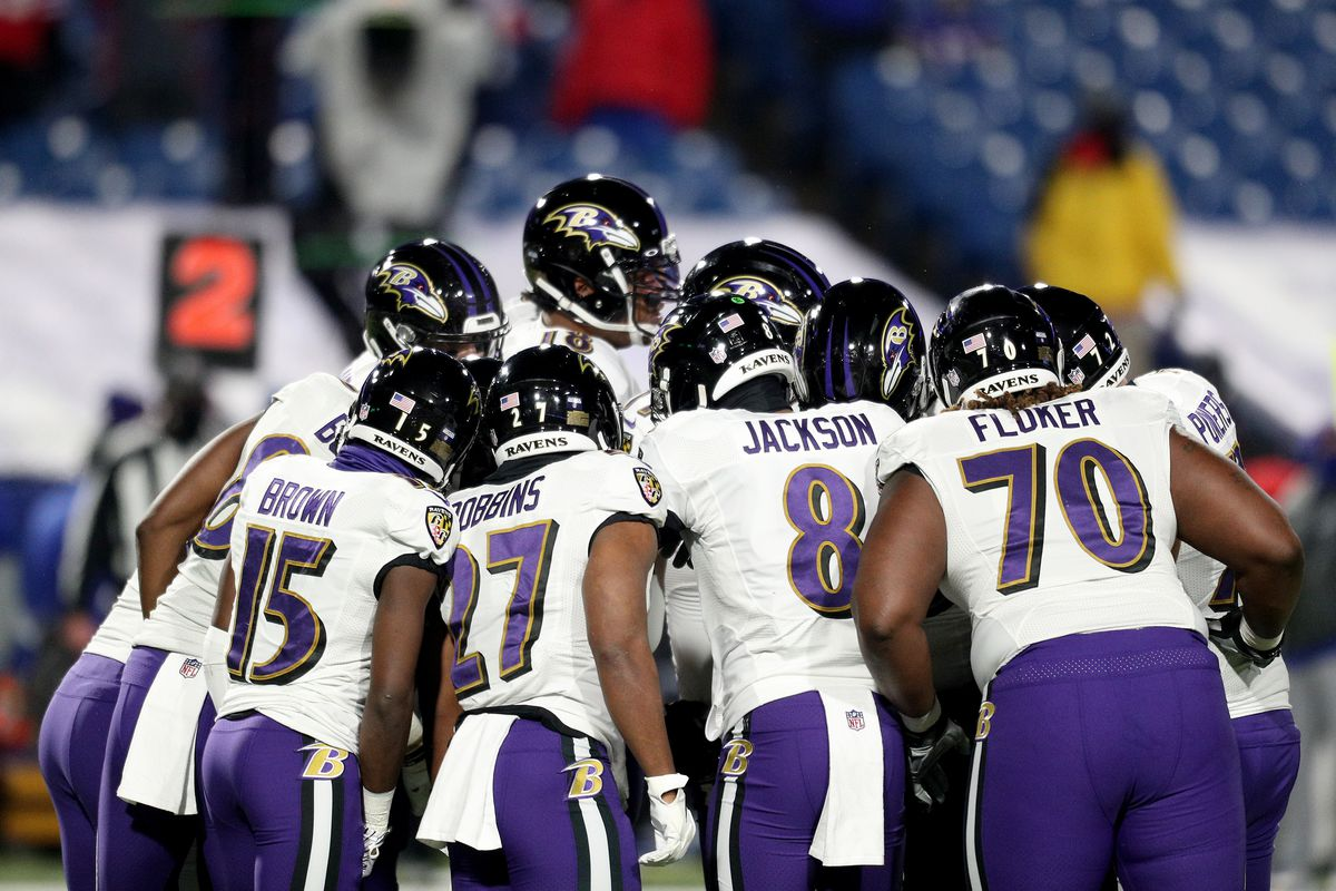 Baltimore Ravens offense huddles during the first quarter of an AFC Divisional Playoff game against the Buffalo Bills at Bills Stadium on January 16, 2021 in Orchard Park, New York.