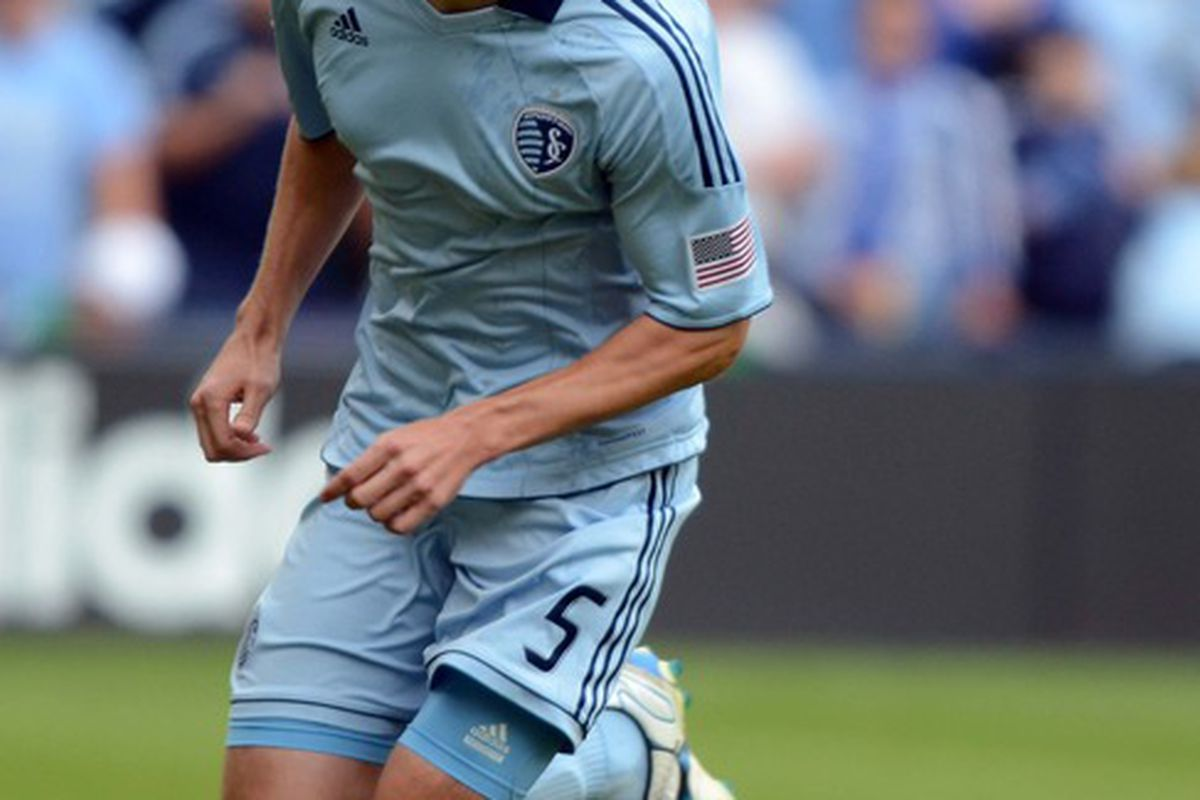 Ap 7, 2012; Kansas City, KS, USA; Sporting KC defender Matt Besler (5) chases the ball against the Los Angeles Galaxy in the first half at Livestrong Sporting Park. Mandatory Credit: John Rieger-US PRESSWIRE