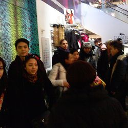 A new set of women's shoppers lines up for the shift change.