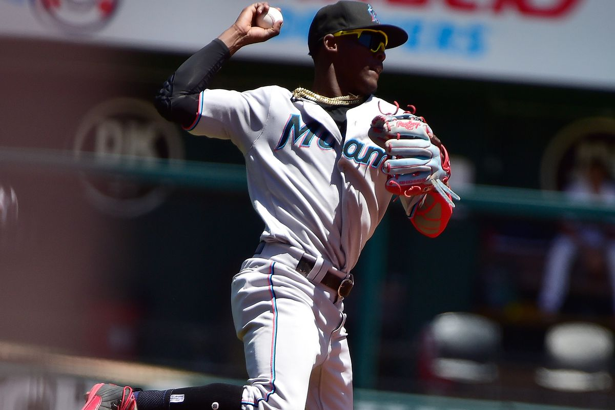 Miami Marlins shortstop Jazz Chisholm Jr. (2) leaps and throws during the sixth inning against the St. Louis Cardinals at Busch Stadium