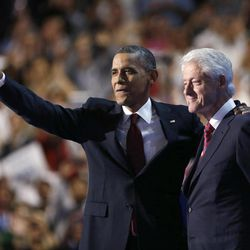 President Barack Obama waves after Former President Bill Clinton addresses the Democratic National Convention in Charlotte, N.C., on Wednesday, Sept. 5, 2012.