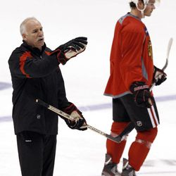 Chicago Blackhawks head coach Joel Quenneville, left, gives instructions as Jonathan Toews skates past during practice on Wednesday, April 11, 2012, in Glendale, Ariz.  The Blackhawks and the Phoenix Coyotes are scheduled to play Game 1 of an NHL hockey Western Conference quarterfinal series on Thursday.