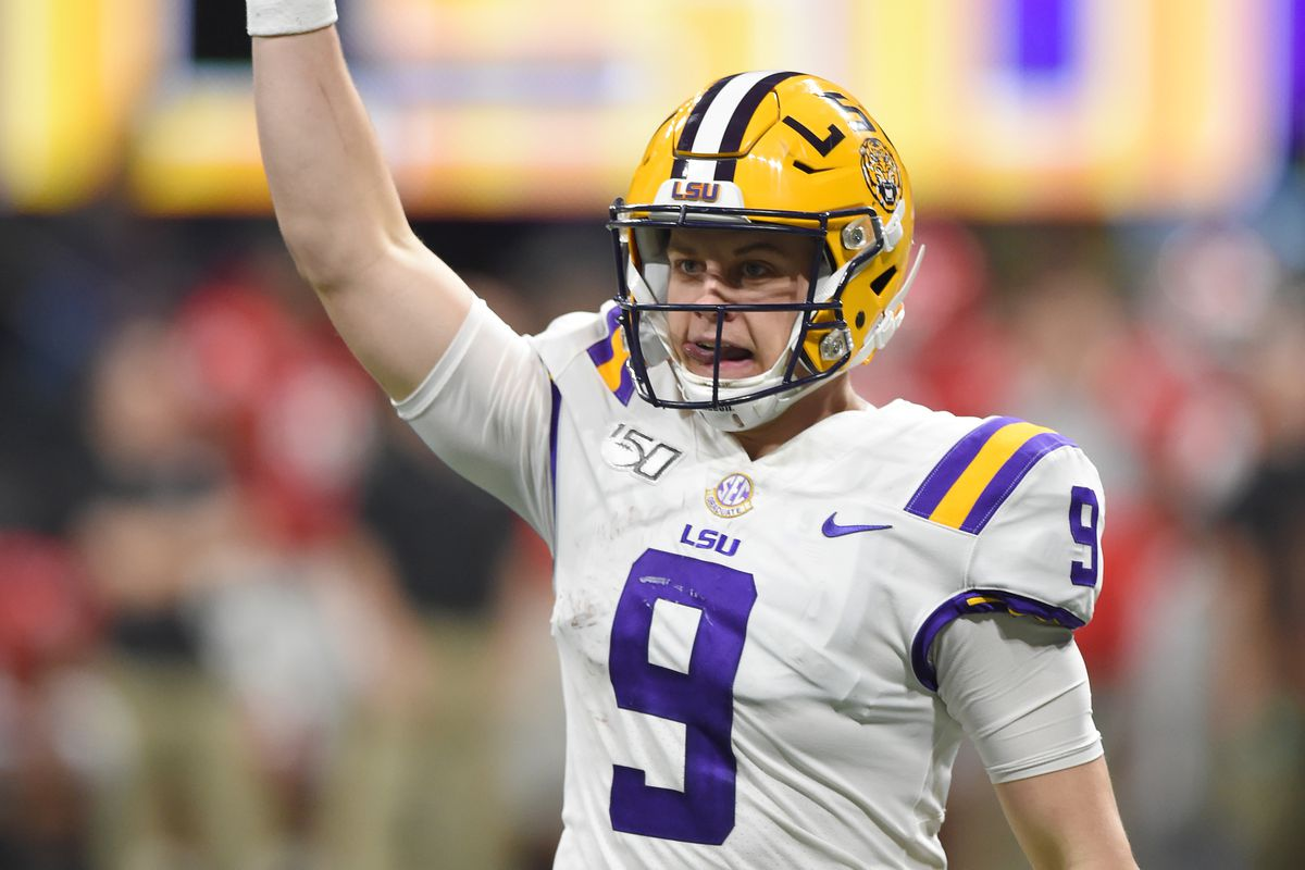 LSU Tigers quarterback Joe Burrow react to a touchdown against the Georgia Bulldogs during the third quarter of the the 2019 SEC Championship Game at Mercedes-Benz Stadium.