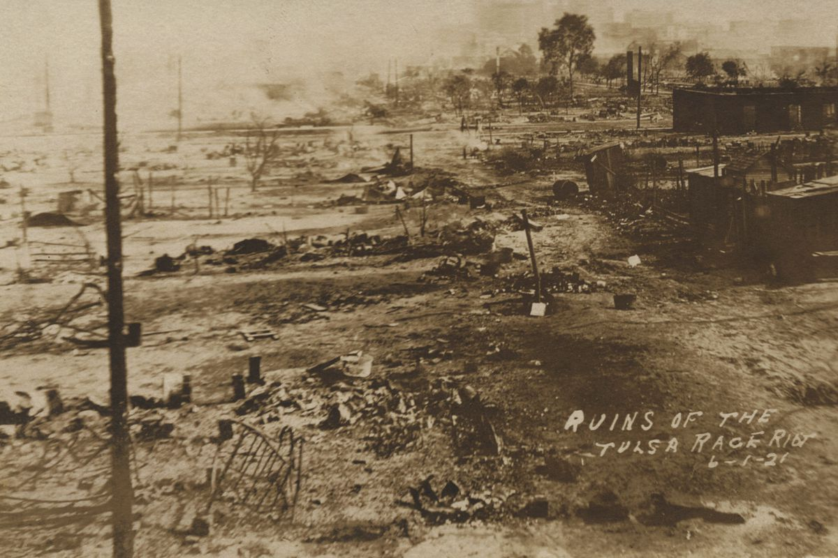 This photo provided by the Department of Special Collections, McFarlin Library, The University of Tulsa shows the ruins of Dunbar Elementary School and the Masonic Hall in the aftermath of the June 1, 1921, Tulsa Race Massacre in Tulsa, Okla.