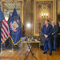 Kem C. Gardner, left, speaks as Utah Gov. Gary Herbert, second from left, stands next to a display of electronic cigarette devices and cartridges at a press conference about vaping held at the Capitol in Salt Lake City on Wednesday, Jan. 29, 2020.