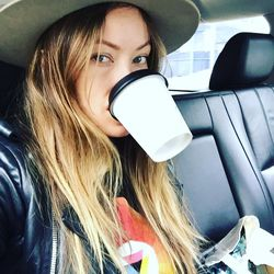 Olivia Wilde getting a cup of coffee in before she starts the glam process.