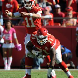 Kansas City Chiefs quarterback Alex Smith (11) motions at the line during the second half of the game against the Oakland Raiders at Arrowhead Stadium. The Chiefs won 24-7.