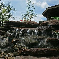 A pond-less waterfall is one of the various do-it-yourself water features homeowners can complete in short time.