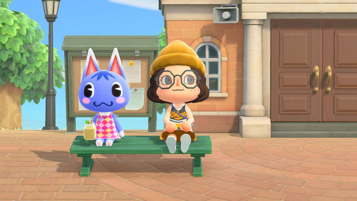 Rosie and a Animal Crossing human sitting on a bench