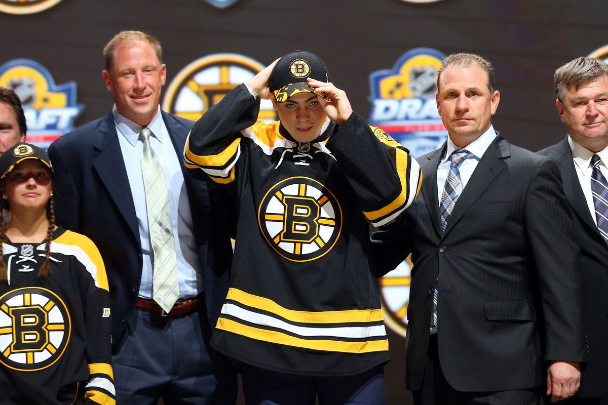 Jake DeBrusk swaps his player hat for a reporter's hat