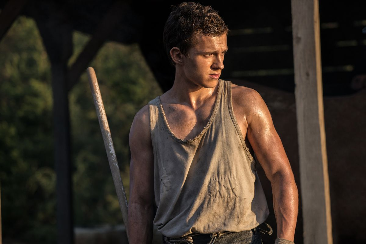 Tom Holland looking especially ripped in a browning tank top in Chaos Walking