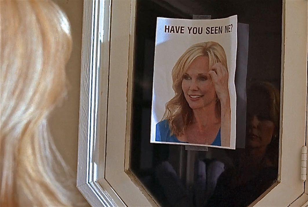 a missing persons poster of a blonde woman