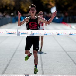 Grantsville's Porter Whitworth crosses the finish line in first place in the 3A Boys State Cross-Country Championships at Highland High School in Salt Lake City on Wednesday, Oct. 23, 2019.