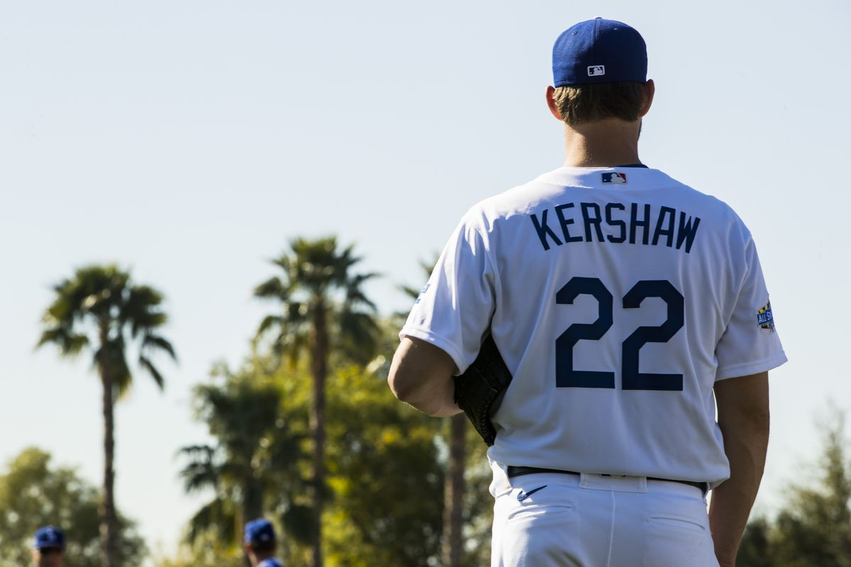 Clayton Kershaw #22 of the Los Angeles Dodgers looks on during a workout after Photo Day on Thursday, February 20, 2020 at Camelback Ranch in Glendale, Arizona.