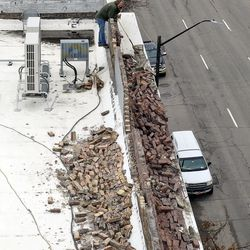 Curtis Green, maintenance worker, assesses damage from the roof ofCaffe Molise and BTG Wine Bar in Salt Lake City after a 5.7 magnitude earthquake centered in Magna hit early Wednesday, March 18, 2020.