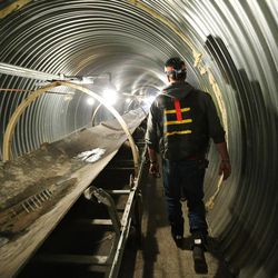 Adrian Childs walks by the reclaimed coal tunnel conveyor belt at the Bronco Utah Mine near Emery on Wednesday, March 29, 2017.