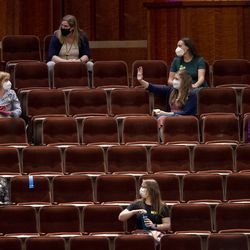 Members of the Tabernacle Choir at Temple Square find their seats as they prepare for rehearsal at the Conference Center in Salt Lake City on Tuesday, Sept. 21, 2021. It was the choir's first rehearsal in more than 18 months.