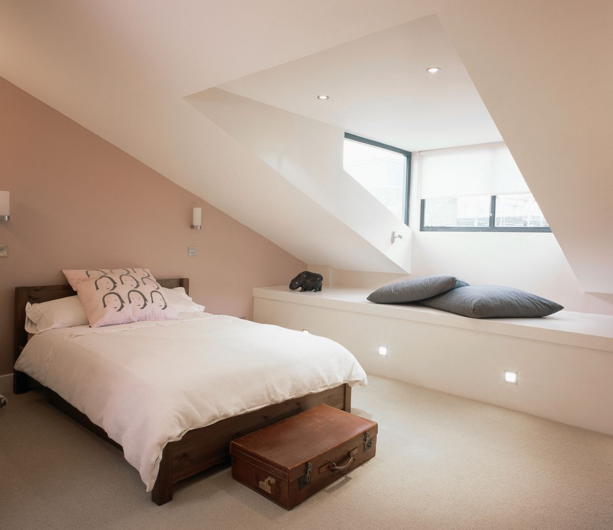 Attic bedroom with recessed lighting.