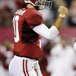 Alabama quarterback AJ McCarron (10) pumps his fist after a touchdown during the first half of an NCAA college football game against the Michigan at Cowboys Stadium in Arlington, Texas, Saturday, Sept. 1, 2012.