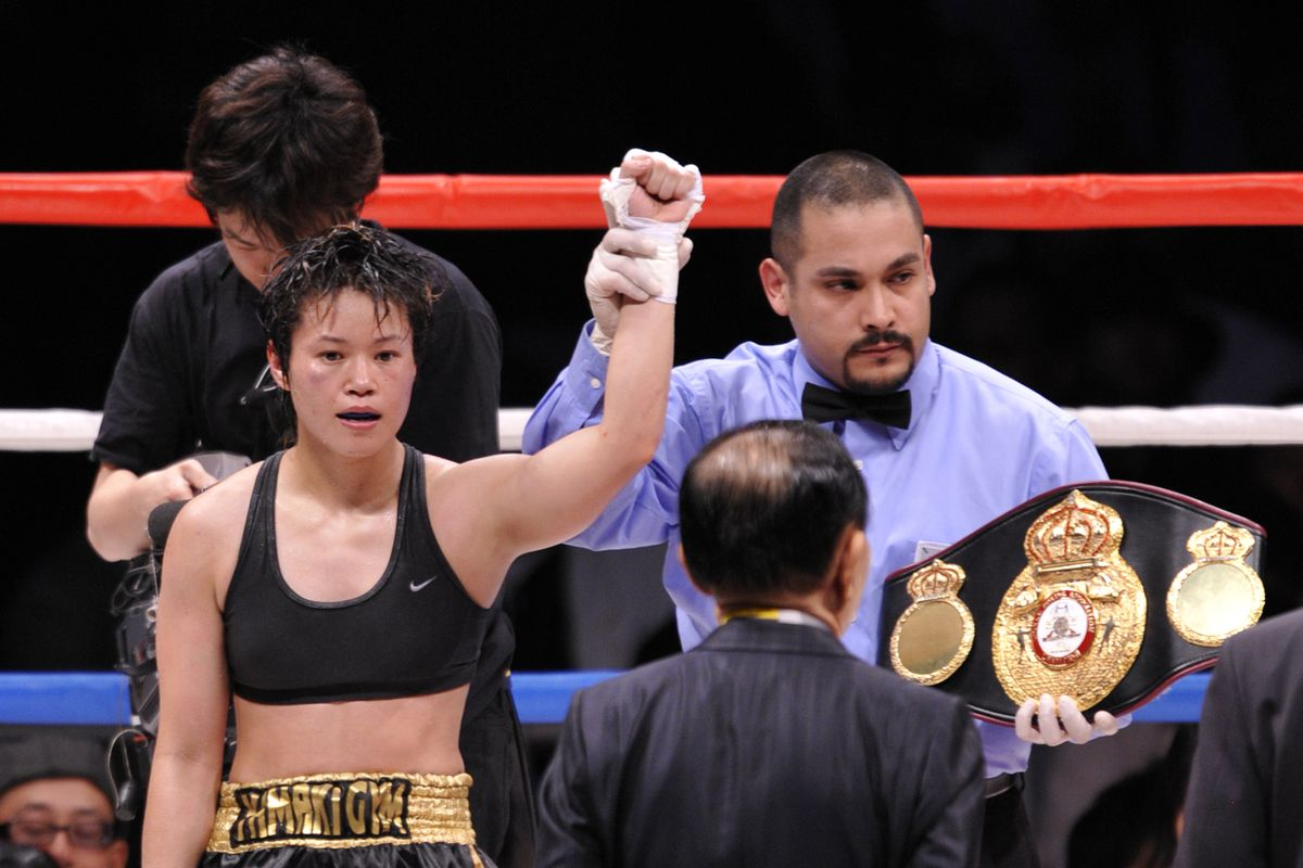 WBA women's super flyweight champion Tsunami Tenkai (L) of Japan celebrates her second title defense against Kayoko Ebata of Japan after their title boxing match at Saitama Super Arena, suburban Tokyo on May 17, 2010. Champion Tenkai won the match. AFP PHOTO/Kazuhiro NOGI