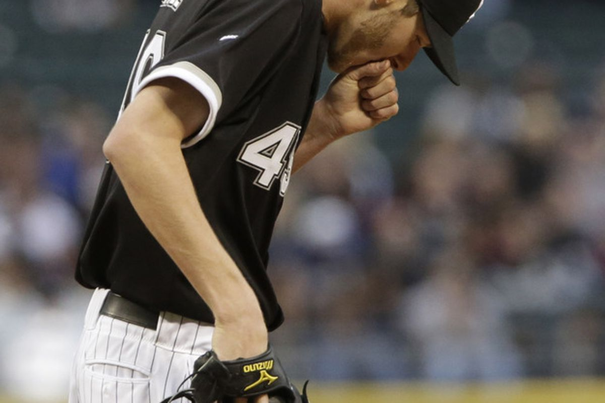 Chris Sale warms his hand, or tries to stop from throwing up.