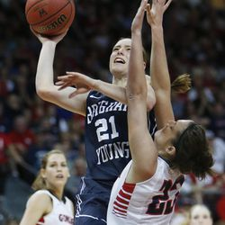 Brigham Young Cougars guard Lexi Eaton (21) shoots over Gonzaga Bulldogs forward Kiara Kudron (23) during the West Coast Conference championship game in Las Vegas Tuesday, March 11, 2014. BYU lost 71-57.
