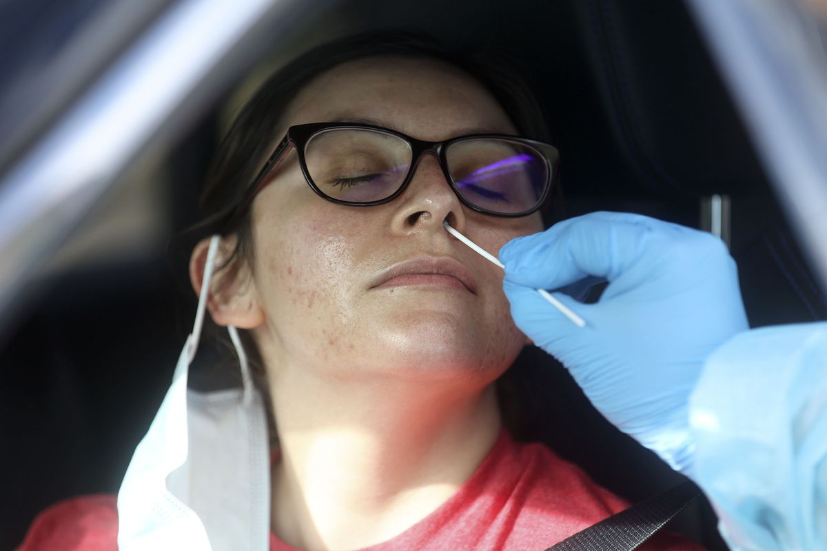 Davena Amezquita is tested for COVID-19 outside of the Utah Department of Health in Salt Lake City on Wednesday, Feb. 10, 2021.