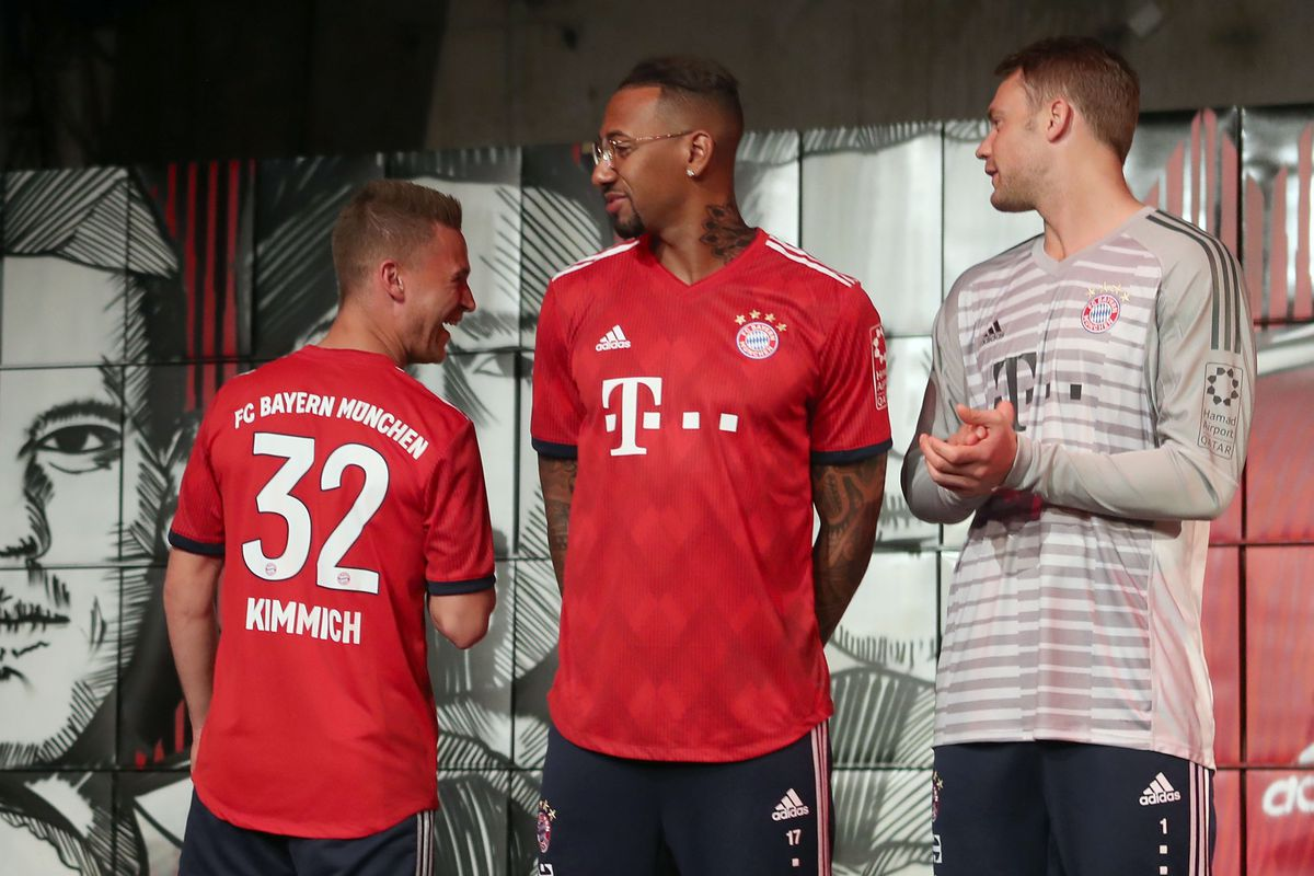 MUNICH, GERMANY - MAY 08: Robert Lewandowki, Joshua Kimmich, Jerome Boateng, injured goalkeeper Manuel Neuer (L-R) of FC Bayern Muenchen are pictured posing with their new unveiled Adidas home jersey for the upcoming Bundesliga season 2018/19 on May 8, 2018 in Munich, Germany.