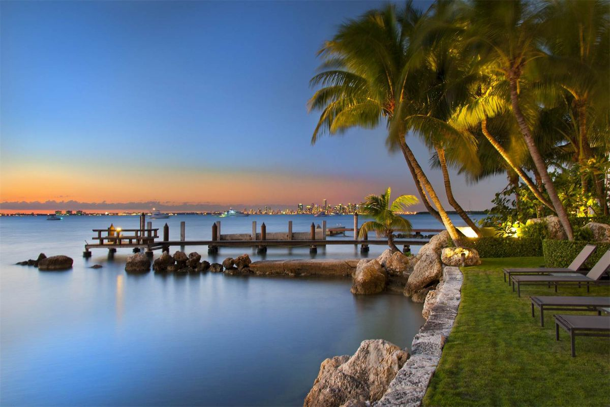 A view from 9 Harbor Point in Key Biscayne showing the downtown miami skyline amid a gorgeous orange sunset