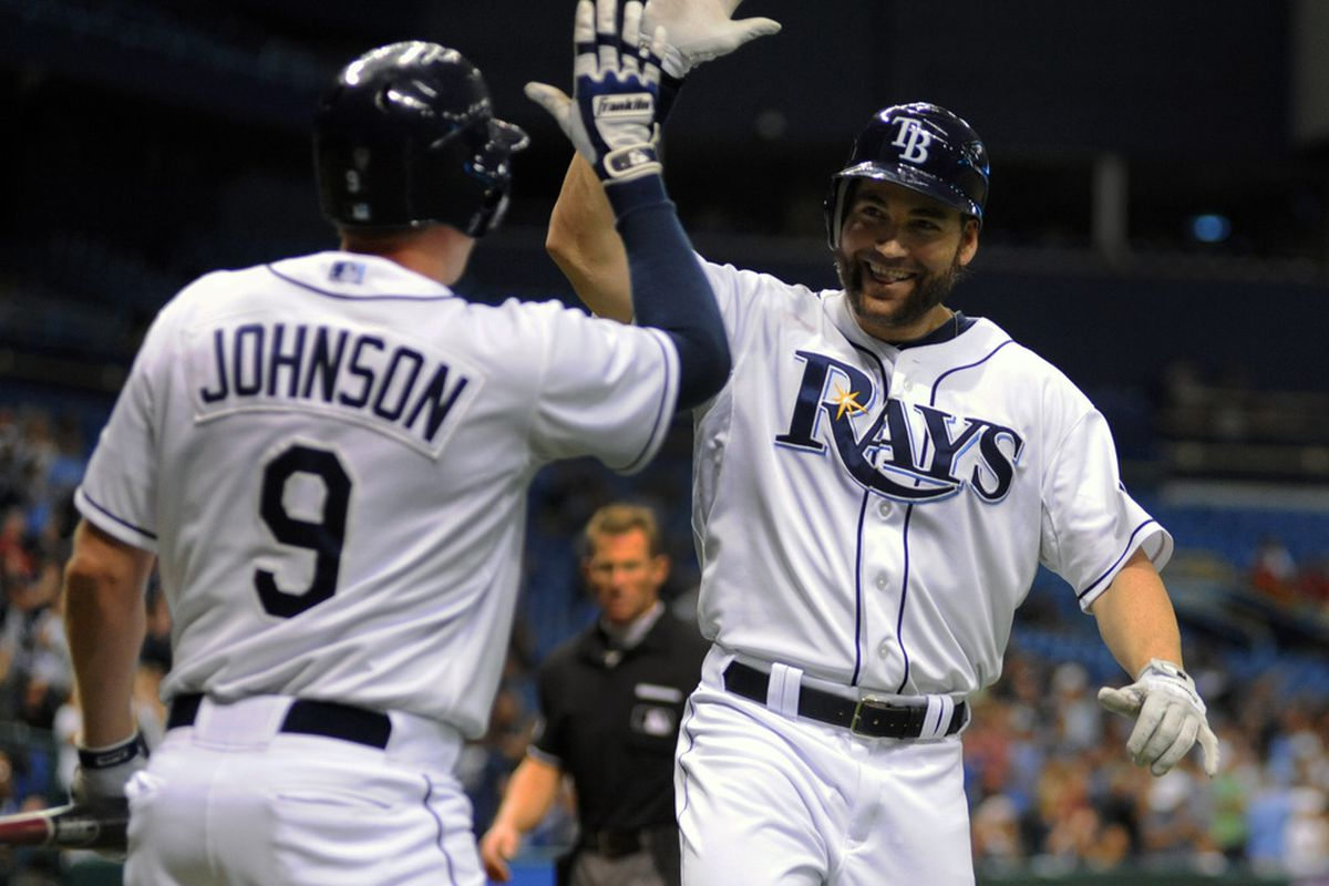 ST. PETERSBURG, FL - MAY 2:  Designated hitter Luke Scott #30 of the Tampa Bay Rays celebrates a sixth-inning home run against the Seattle Mariners May 2, 2012  at Tropicana Field in St. Petersburg, Florida.  (Photo by Al Messerschmidt/Getty Images)