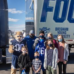 Friends, family, and neighbors gather to watch Brandon Stewart go for a ride in BYU football's equipment semi in Clinton on Saturday, Jan. 30, 2021. The ride was his final wish as he battles cancer.