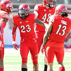 Utah's Armand Shyne (23), Karsen Liljenquist (48), and Jordan Fogal (13) cheer during the annual Red & White Spring Game at Rice-Eccles Stadium in Salt Lake City on Saturday, April 15, 2017.