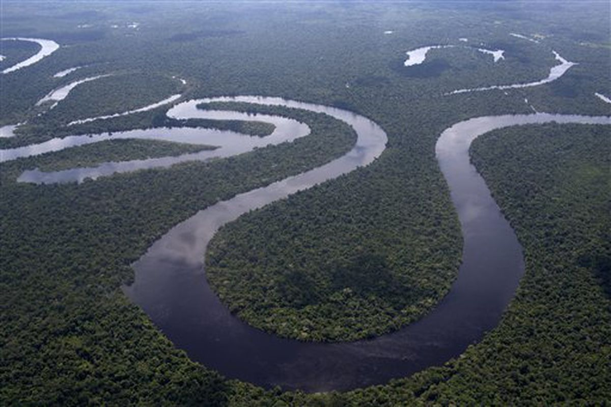 This April 18, 2015 aerial photo shows the Nanay River winding through Peru's Amazon jungle near Iquitos.