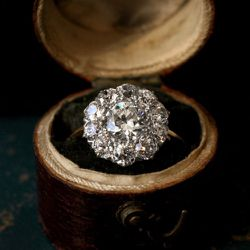 1900s Edwardian European cut diamond cluster ring, platinum, 18K. The English made beautiful cluster rings at the turn of the century, often with platinum tops and yellow gold shanks. The silvery luster of old diamonds is especially well suited for cluste