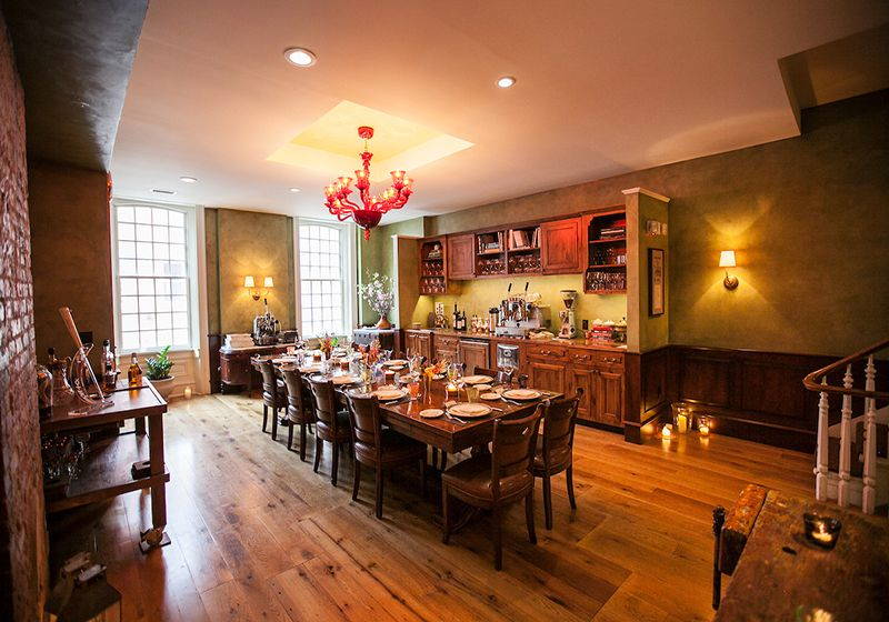 dining room with wood floors and long table