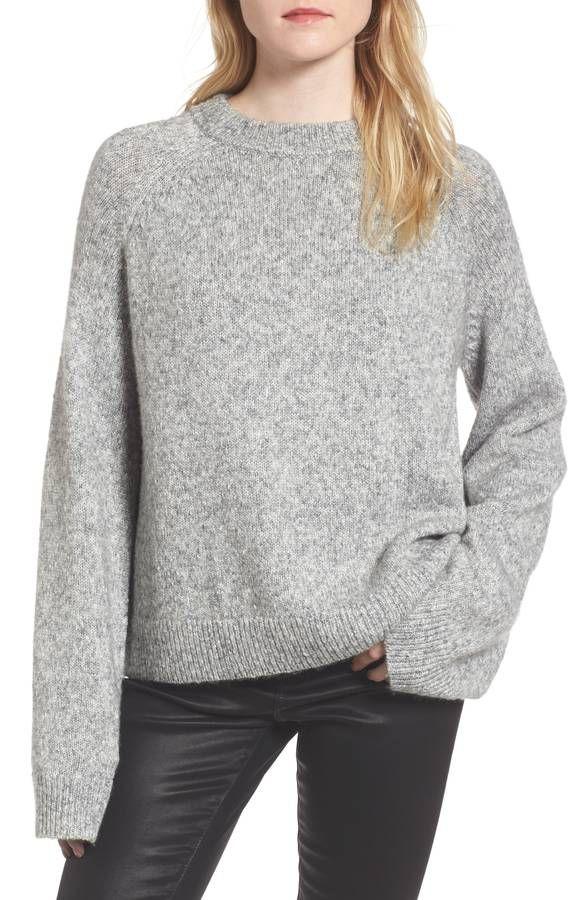 model in gray sweater