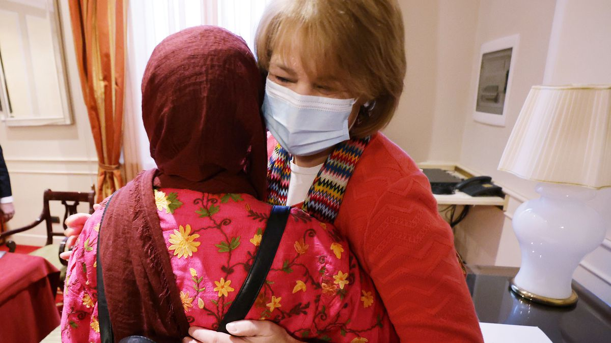 G20 Interfaith Forum: Sister Sharon Eubank, first counselor in The Church of Jesus Christ of Latter-day Saints' Relief Society general presidency, hugs Dr. Azza Karam, Religions for Peace,
