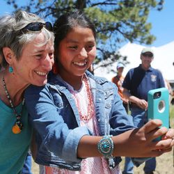 Interior Secretary Sally Jewell takes a photo with Bahazhoni Filfred as she visits with Native Americans near the Bears Ears in southern Utah on Friday, July 15, 2016.