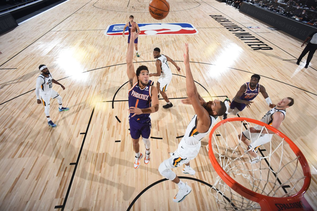 Devin Booker of the Phoenix Suns shoots the ball during the game against the Utah Jazz during a scrimmage on July 23, 2020 at The Arena at ESPN Wide World of Sports in Orlando, Florida.