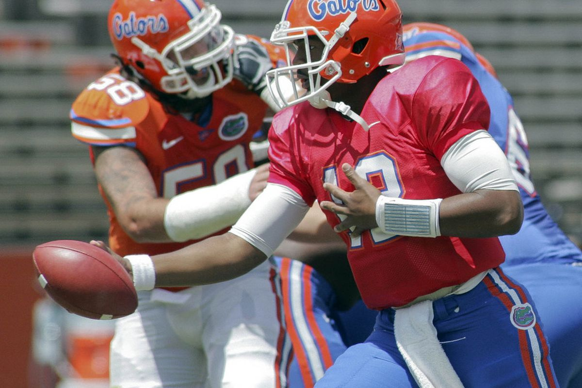 April 7, 2012; Gainesville FL, USA; Florida Gators quarterback Jacoby Brissett (12) hands off the ball during the first half of the Florida spring game at Ben Hill Griffin Stadium. Mandatory Credit: Phil Sears-US PRESSWIRE