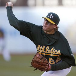 Oakland Athletics starting pitcher A.J. Griffin (64) works against the Boston Red Sox in the first inning of a baseball game Saturday,  Sept. 1, 2012 in Oakland, Calif.