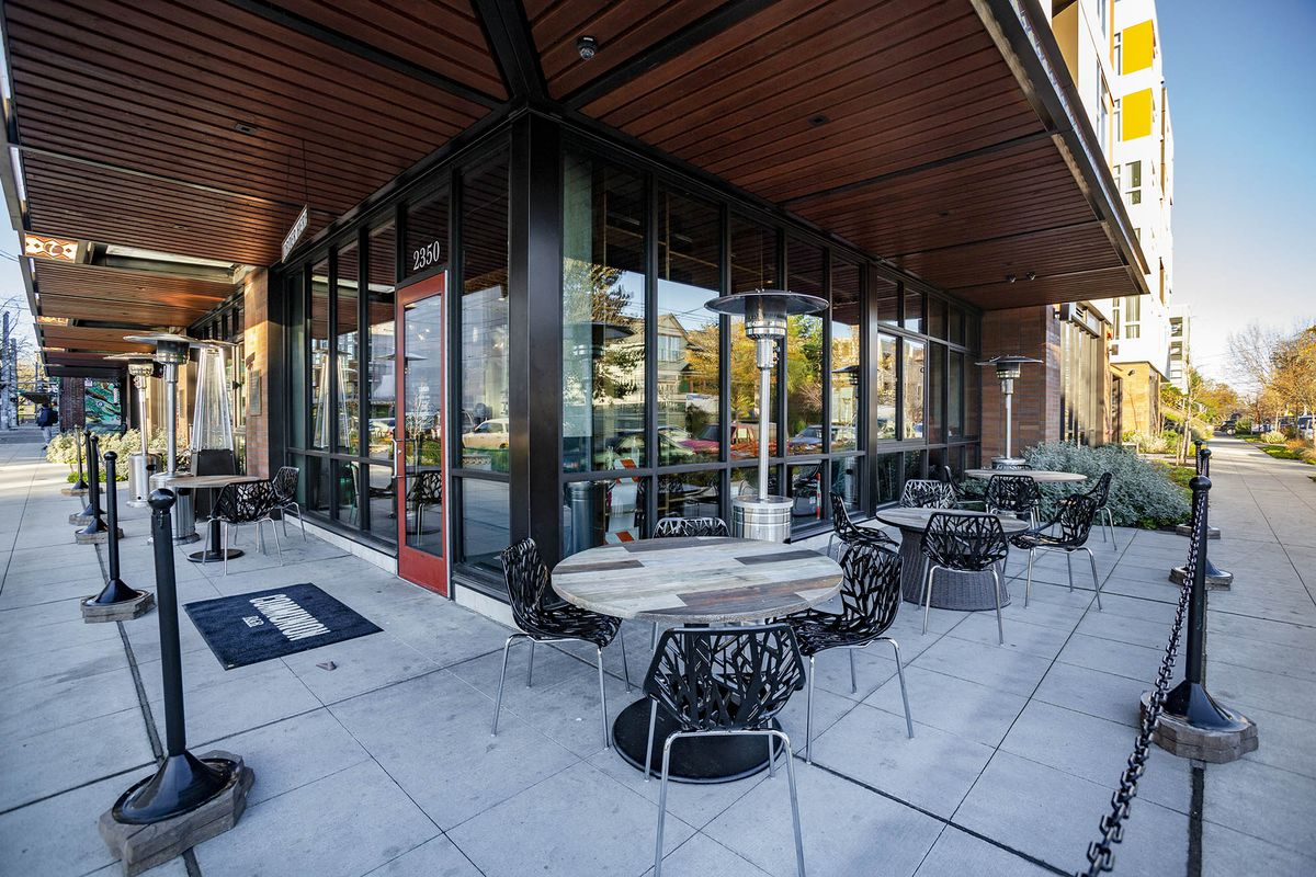 Outdoor seating with heat lamps outside Communion