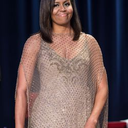 Michelle Obama wears a Givenchy Haute Couture gown, Harry Kotlar earrings, Le Vian rings and a Maxior ring.