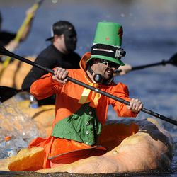 Kyle Fox wins his heat before winning the 2013 Mountain Valley Seed Co. Ginormous Pumpkin Regatta at Sugarhouse Park on Saturday, October 19, 2013.